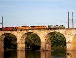 CSX 7527, BNSF 5511, 8263 lead oil train K-144 across the Delaware River